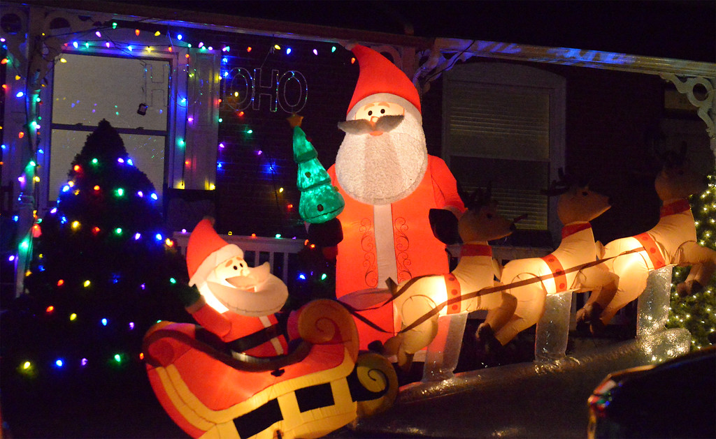 . (Bob Raines-/Digital First Media)  Two blow-up Santas and a sleigh on York St., Lansdale Dec. 21, 2017.