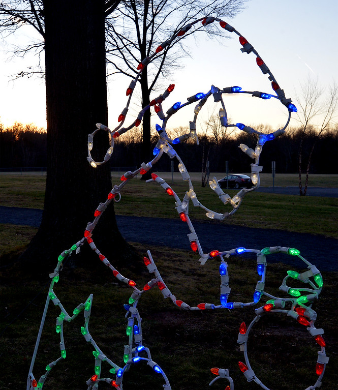 . Bob Raines--Digital First Media(Bob Raines-/Digital First Media) An elf silhouette made of lights gets ready for Christmas at Fischer\'s Park Dec. 20, 2017.
