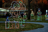 (Bob Raines-/Digital First Media) <br /> A couple takes a walk past lighted figures of an elf and some carolers in Fischer's Park, Towamencin Wednesday, Dec. 20, 2017.