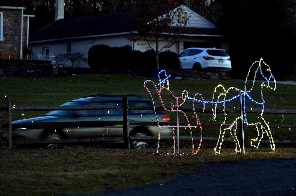 . (Bob Raines-/Digital First Media)  A horse and sleigh seem to trot along Bustard Rd. in Fischer\'s Park Dec. 20, 2017.