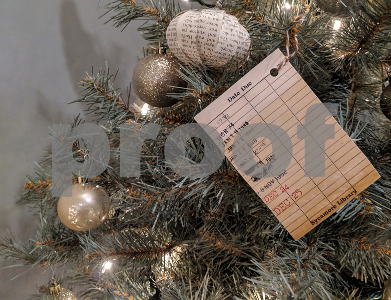 Ghosts of libraries past – the Sycamore Public Library's entry to the Festival of Trees includes some library cards that pre-date bar codes and scanners. The exhibit runs at the Midwest Museum of Natural History in Sycamore through the end of the year.