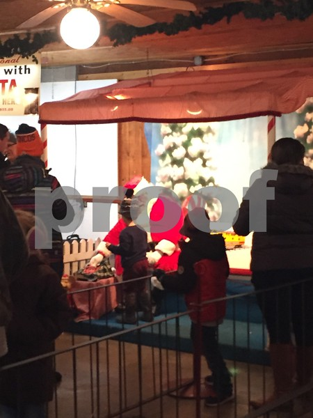 Children meet Santa and share their Christmas wish lists Saturday in Waterman.