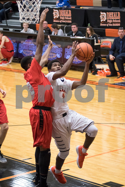 Sam Buckner for Shaw Media.<br /> Michael Albert takes a layup on Wednesday December 27, 2017 against Huntley High School.