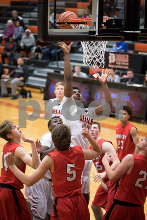 Sam Buckner for Shaw Media.<br /> Marcus Bobo makes a shot after being fouled on Wednesday December 27, 2017 against Huntley High School.