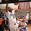 Sam Buckner for Shaw Media.<br /> Darvon Sisson dunks against Marmion on Wednesday December 28, 2016.