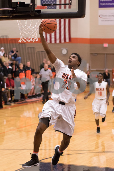 Sam Buckner for Shaw Media.<br /> Marcus Bobo shoots a layup in the second round of the Chuck Dayton tournament against Marmion on Wednseday December 28, 2016.