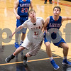 Sam Buckner for Shaw Media.<br /> Michael Vilet guards Riley Friel of Marmion on Wednesday December 28, 2016.