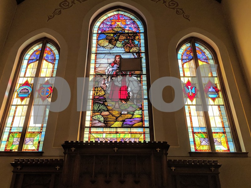 The stained glass window behind the altar at St. John's Lutheran Church in Somonauk Dec. 27. The window was broken by a jar of olives propelled through it earlier in December.