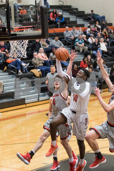 Sam Buckner for Shaw Media.<br /> Michael Newman goes up for a layup while being fouled on Thursday December 28, 2017.