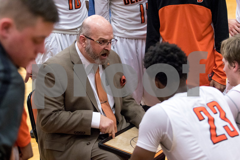 Sam Buckner for Shaw Media.<br /> Head Coach Al Biancalana shows a play on his dry erase board during a time out on Thursday December 28, 2017.
