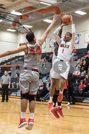 Sam Buckner for Shaw Media.<br /> Jordan Williams takes a jump shot on Thursday December 28, 2017.