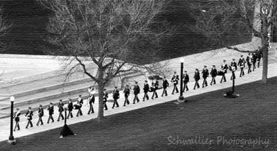 A military band makes its way into Ah-Nab-Awen Park and the grounds of the Gerald R. Ford Presidential  Museum in Grand Rapids for the funeral of the former President in Grand Rapids, Mich., Tuesday 1/2/07. (Photo by Lance Wynn/Grand Rapids Press)