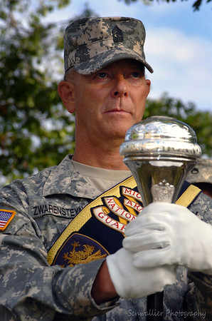 1SG  JAMES JAY CORNE ZWARENSTEYN, Drum Major of the 126 Army Band, Michigan Army National Guard, is unaffected by the photographer as he holds his pose steady during a memorial ceremony being held for Michigan National Guard Soldiers who lost their lives in the war on terrorism.(Photo by SSG Helen Miller, Michigan Army National Guard.) Released.