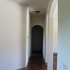 Hallway to the master suite, garage and utility room