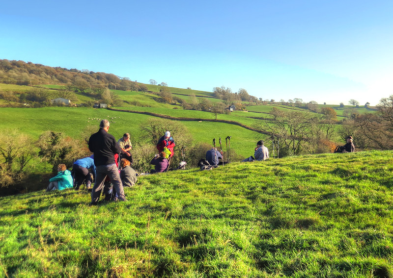 The group settles down for lunch - there were cattle in the field...