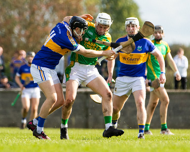 Toomevara's Russell Quirke in action against Kiladangan's Willie Connors and Jack Loughnane in the Tipperary Senior Hurling Quarter final in Cloughjordan