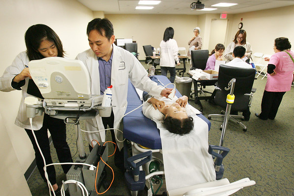 Participants are seen receiving medical screening consultation at the 2013 Korean Health Festival held at Holy Name Medical Center in Teaneck. The Holy Name Laboratory processed the blood tests for 1,000 Korean Americans, and the results were returned to patients at the health festival.9/28/2013  photo by Jerry McCrea