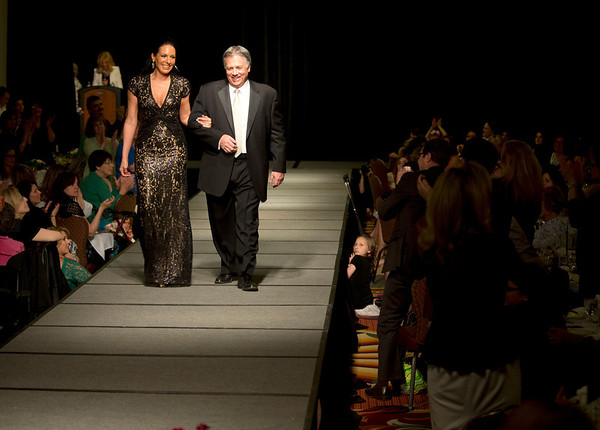 Larry Inserra, Jr., President of Inserra Supermarkets, and his wife Inez Inserra walk down the runway at  the 2013 Holy Name Medical Center MS Center Fashion Fling at the Glenpointe Marriott in Teaneck NJ. <br /> The Holy Name MS Center is one of the few certified multiple sclerosis centers in the tri-state area, and the only certified facility in Bergen County. The Center offers multiple sclerosis patients from New Jersey and surrounding areas a place where all their MS treatments needs can be met in one location. 4/28/13 Photo by Jeff Rhode / Holy Name Medical Center