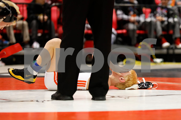 Rory Burright of Huntley Middle School takes a moment on the mat Saturday, March 10 after loosing his IESA championship match.<br /> <br /> Sarah Minor - For Shaw Media