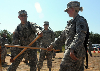 In this image released by the Texas Military Forces, Soldiers with the 236th Military Police Company handle defensive batons at Camp Swift, Texas, Wednesday, July 27, 2011. As part of the Joint Task Force 71's Annual Training, the MPs spent the day practicing security operations and riot control to support the JTF-71's Homeland Response Force. During a HRF response at an incident, MPs will partner with civilian law enforcement to contain the site and protect against civil disturbances. (Photo/100th Mobile Public Affairs Detachment, Army National Guard Sgt. Suzanne M. Carter)