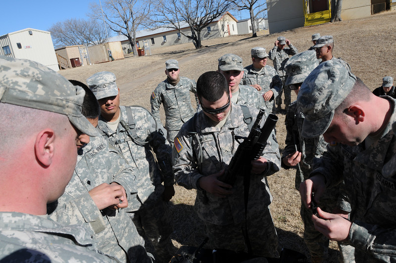 """In this image released by the Texas Military Forces, Soldiers from 236th Military Police Company perform basic soldier tasks during annual training at Fort Wolters, Texas, Friday, Jan. 28, 2011. The unit, headquartered in San Antonio, is in the Dallas/Fort Worth with Joint Task Force 71 in support of the Super Bowl mission. Annual training enables National Guard units like the 236th to maintain their soldiering skills, facilitating them to be """"Always Ready-Always There"""". (Photo/Joint Task Force 71, Army National Guard Sgt. Melissa Shaw)"""