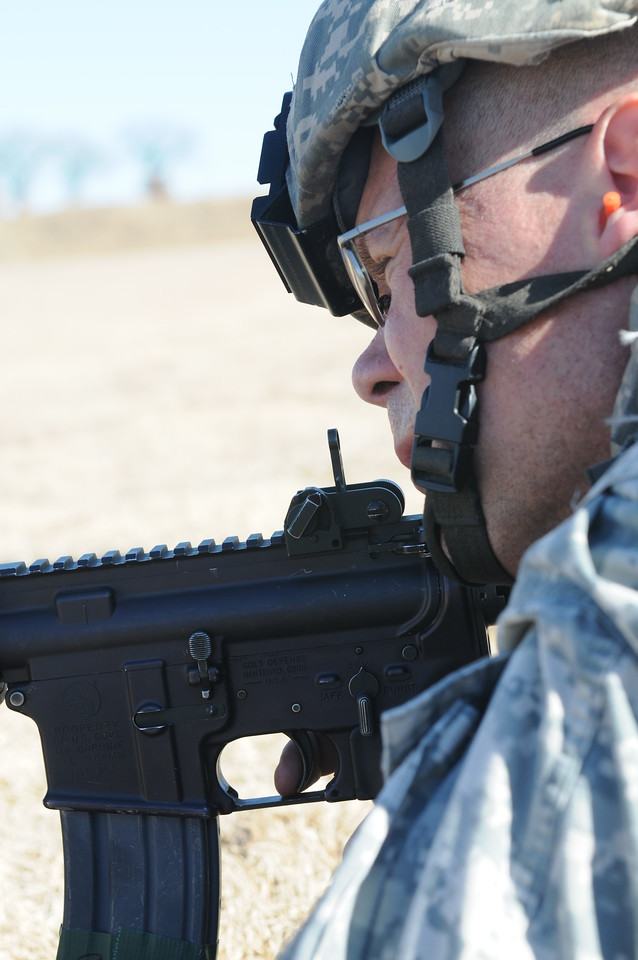 """In this image released by the Texas Military Forces, Soldiers from 236th Military Police Company earn weapons qualification during annual training at Fort Wolters, Texas, Friday, Jan. 28, 2011. The unit, headquartered in San Antonio, is in the Dallas/Fort Worth with Joint Task Force 71 in support of the Super Bowl mission. Annual training enables National Guard units like the 236th to maintain their soldiering skills, facilitating them to be """"Always Ready-Always There"""". (Photo/Joint Task Force 71, Army National Guard Sgt. Melissa Shaw)"""