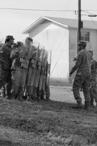 In this image released by the Texas Military Forces, Soldiers from the 236th Military Police rehearse riot control operations during annual training at Fort Wolters, Texas, Wednesday, Jan. 26, 2011. The unit, headquartered in San Antonio, fell in on the operations center Joint Task Force 71 set up earlier in the week in the Dallas/Fort Worth area in support of Super Bowl 45.  Sustaining proficiency in non-lethal tactics enables success when the unit is called upon to assist civilian authorities. (Photo/Joint Task Force 71, Staff Sgt. Carolina Bonham)