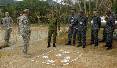 In this image, released by JTF-71 (MEB), members of the 606th Military Police Company conduct detainee training at Camp Hansen in Okinawa, November 6, 2012. This annual training period enhances the unit's capabilities and keeps their military police skills fresh. Photo by Army Spc. Mario Padilla.