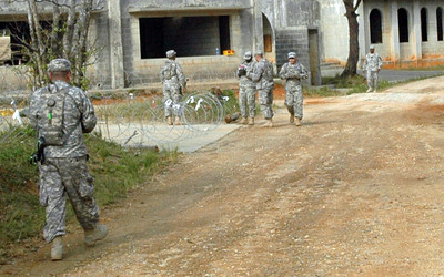 In this image, released by JTF-71 (MEB), members of the 606th Military Police Company conduct detainee training at Camp Hansen in Okinawa, November 6, 2012. This annual training period enhances the unit's capabilities and keeps their military police skills fresh. Photo by Army Spc. Javier Martinez.