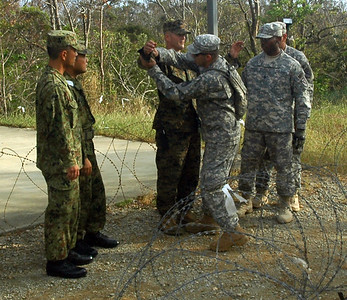 In this image, released by JTF-71 (MEB), members of the 606th Military Police Company conduct detainee training at Camp Hansen in Okinawa, November 5, 2012. This annual training period enhances the unit's capabilities and keeps their military police skills fresh. Photo by Army Spc. Mario Padilla