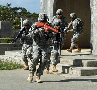 In this image, released by JTF-71 (MEB), members of the 606th Military Police Company conduct detainee training at Camp Hansen in Okinawa, November 8, 2012. This annual training period enhances the unit's capabilities and keeps their military police skills fresh. Photo by Army Spc. Mario Padilla.