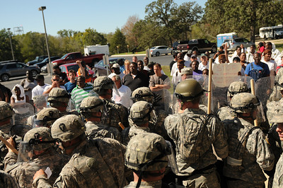 In this image released by the Texas Military Forces, Soldiers with the 236th Military Police Company control an unruly crowd during the Texas Military Forces' Homeland Response Force certification exercise at a Texas Engineering Extension Service training facility in College Station, Texas, Thursday, October 13, 2011. Joint Task Force 71 completed the exercise as part of a National Guard Bureau certification process that highlighted the unit's Homeland Response Force capabilities in support of potential large-scale disasters in FEMA Region 6. The certification was the culmination of 18 months worth of training and recognizes the value that Texas Military Forces bring to the public and the emergency response community. (Photo/100th Mobile Public Affairs Detachment, Army National Guard Spc. Luke Elliott)