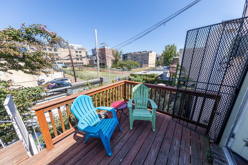Back deck, facing the 12/13 and T/U St alleyway block, with spiral stairs down to my level.