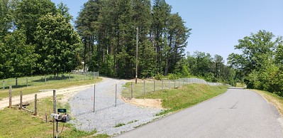 Fenced road frontage with new driveway entrance
