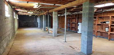 Spacious basement. This photo shows only half of the basement. The wood wall divides the basement in half.
