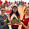 Holding up one of the 34 Gingerbread houses at the 13th Annual Gingerbread House Competition and fundraiser are the teen volunteers L-R, Madelyn Archambault, Rosalie Pineda and Rachel McIntosh all 15 years old and Dracut HS students. SUN/ David H. Brow