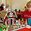 Looking over one of the many Gingerbread Houses  (this one called Red Barn made by Rachel Antifonario of Dracut) at the 13th annual Rotary Clubs Gingerbread Competition and fundraiser in Dracut is Caleb Kunicki 8 of Dracut. SUN/ David H. Brow