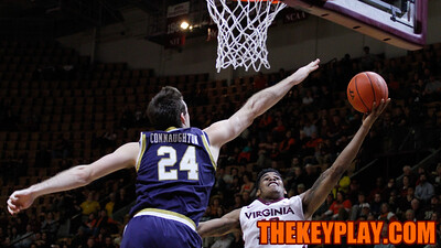 Ahmed Hill (13) attempts a layup over Pat Connaughton. (Mark Umansky/TheKeyPlay.com)