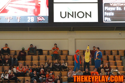 Students dresed as Mario, a banana, and Superman sit high up in the student section in the second half. (Mark Umansky/TheKeyPlay.com)