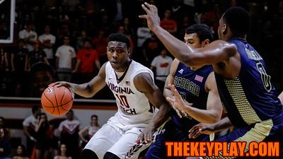 Justin Bibbs tries to get around a pair of Georgia Tech players in the second half. (Mark Umansky/TheKeyPlay.com)