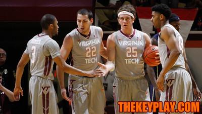 Adam Smith, Christian Beyer, Will Johnston, and Jalen Hudson huddle up after Virginia Tech earns a foul. (Mark Umansky/TheKeyPlay.com