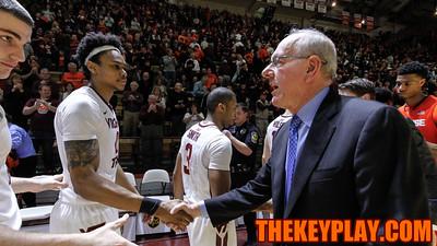 Syracuse head coach Jim Boeheim shakes hands with Shane Henry after the game. (Mark Umansky/TheKeyPlay.com)