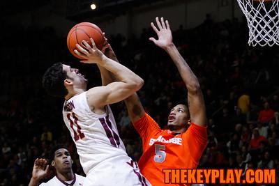 Devin Wilson tries to float the ball over Chris McCullough. (Mark Umansky/TheKeyPlay.com)