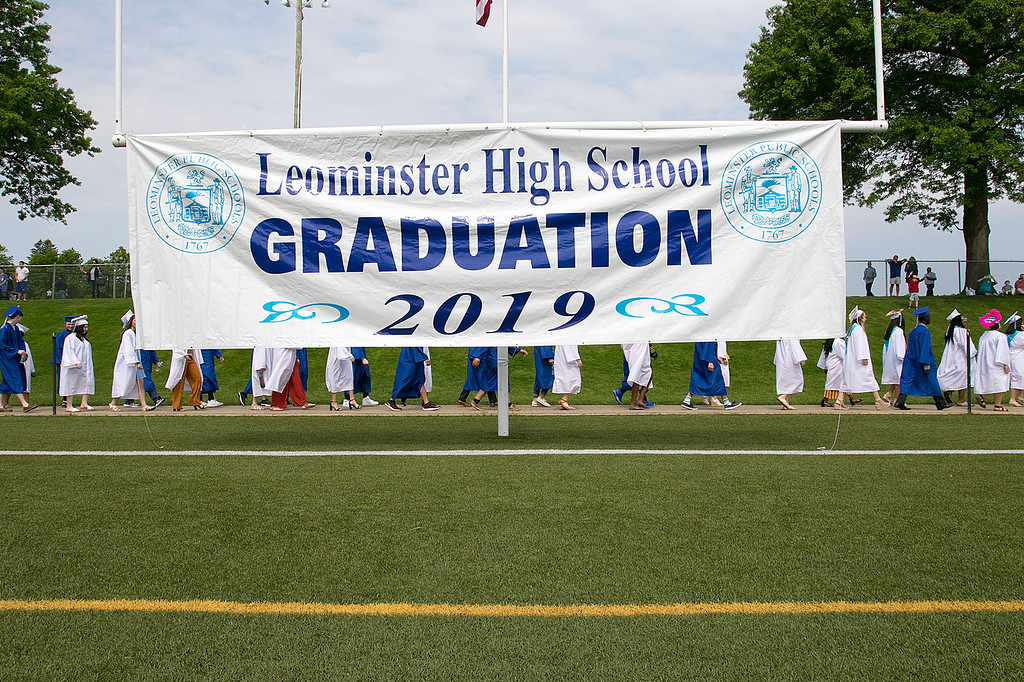 . The 149th graduation exercise for Leominster High School was held on Saturday, June 1, 2019 at Doyle Field. Graduates parade onto the field by a graduation sign on the field. SENTINEL & ENTERPRISE/JOHN LOVE