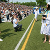 The 149th graduation exercise for Leominster High School was held on Saturday, June 1, 2019 at Doyle Field. Graduate Phetemany Simmalavong stops for a moment so friend Pim Phetsang and her dad Andrew Mauro, kneeling, could snaps some pictures of her after she got her diploma. SENTINEL & ENTERPRISE/JOHN LOVE