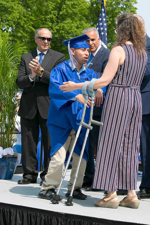 . The 149th graduation exercise for Leominster High School was held on Saturday, June 1, 2019 at Doyle Field. Graduate Andres Buenahora had asked to walk across the stage by himself with out crutches or help from anyone. As he did it he got a standing ovation from his classmates. He had not told his parents , this was a surprise. SENTINEL & ENTERPRISE/JOHN LOVE