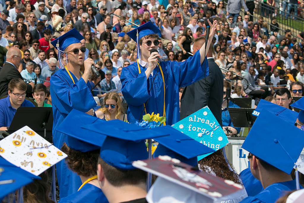 ". The 149th graduation exercise for Leominster High School was held on Saturday, June 1, 2019 at Doyle Field. Graduates listen to their fellow classmates Jimmy Kran and Rory Young sing the Class Song ""Good Old Days\"" during the ceremony. SENTINEL & ENTERPRISE/JOHN LOVE"