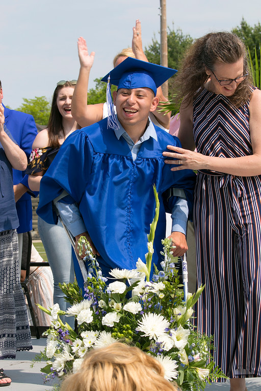 . The 149th graduation exercise for Leominster High School was held on Saturday, June 1, 2019 at Doyle Field. Graduate Andres Buenahora had asked to walk across the stage by himself with out crutches or help from anyone. As he did it he got a standing ovation from his classmates. He had not told his parents , this was a surprise. He made it with a big smiles on his face. SENTINEL & ENTERPRISE/JOHN LOVE