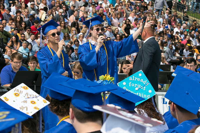 "The 149th graduation exercise for Leominster High School was held on Saturday, June 1, 2019 at Doyle Field. Graduates listen to their fellow classmates Jimmy Kran and Rory Young sing the Class Song ""Good Old Days"" during the ceremony. SENTINEL & ENTERPRISE/JOHN LOVE"