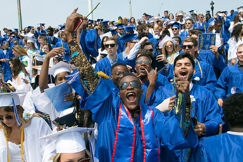The 149th graduation exercise for Leominster High School was held on Saturday, June 1, 2019 at Doyle Field. Graduate Lucas Adjei, in shades, celebrates the graduation  with his fellow classmates at the end of the ceremony. SENTINEL & ENTERPRISE/JOHN LOVE